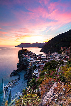 A stunning sunset over the old town and harbour of Vernazza, Cinque Terre, UNESCO World Heritage Site, Liguria, Italy, Europe