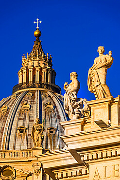 St. Peter's Basilica Cupola and statues in early morning light, Vatican City, Rome, Lazio, Italy, Europe