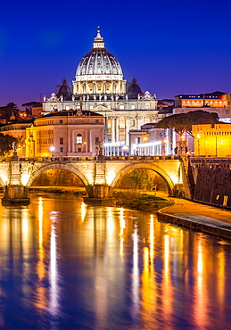St. Peter's Basilica in Vatican City lit up after dark and Tiber River, Rome, Lazio, Italy, Europe