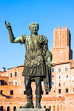 Statue of the Emperor Trajan with Trajan's Forum and market to the rear, Rome, Lazio, Italy, Europe