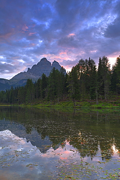 Three Peaks of Lavaredo reflected in the Antorno Lake during sunrise, Sesto Dolomites, Belluno Province, Veneto, Italy, Europe