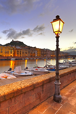 Street lamp lit along the river during twilight, Bosa, Oristano province, Sardinia, Italy, Mediterranean, Europe