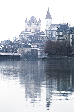 Old city of Thun is reflected in the Aare River, Thun, Canton of Bern, Switzerland, Europe