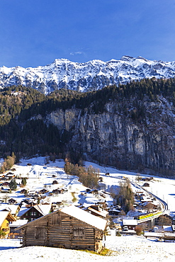 Traditional huts with the transit of the train, Lauterbrunnen, Canton of Bern, Switzerland, Europe