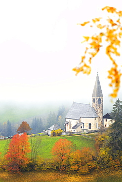 Church of Santa Magdalena in the autumn mist, Funes Valley, Sudtirol (South Tyrol), Dolomites, Italy, Europe