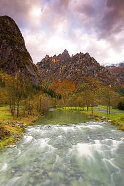 Torrent surmounted by mountains at sunrise, Valmasino, Valtellina, Lombardy, Italy, Europe