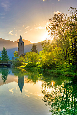 Traditional church of Sils facing Inn River at sunrise, Sils Maria, Engadine valley, Graubunden, Switzerland, Europe