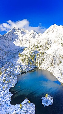 Aerial view of Lago Nero after a summer snowfall, Val Belviso, Valtellina, Orobie Alps, Lombardy, Italy, Europe