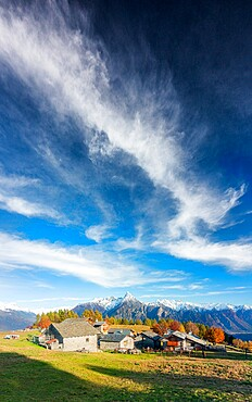 Amazing clouds above the traditional mountain village, Valchiavenna, Lombardy, Italy, Europe