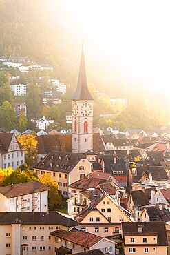 Sunlight illuminates the old town of Chur, Canton Graubunden, Switzerland, Europe