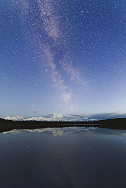 Milky way rises above Mount Denali (Mount McKinley), viewed from the Reflection Pond, Alaska, United States of America, North America