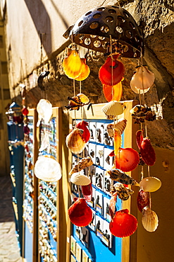 Colourful souvenirs and sea shells for sale in Crete, Greek Islands, Greece, Europe