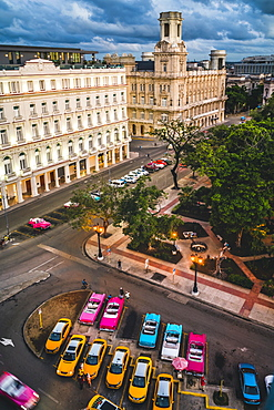Aerial view colourful old American taxi cars parked in Havana at dusk, La Habana, Cuba, West Indies, Caribbean, Central America