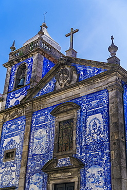 Facade of Chapel of Souls, covered with azulejo blue and white painted ceramic tiles, Capela das Almas Church, Porto, Portugal, Europe