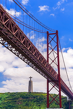Ponte 25 de Abril Bridge with Cristo Rei statue (Christ the King Sanctuary) behind, suspension bridge over the Tagus River, Lisbon, Portugal, Europe