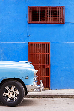 Front of old vintage car parked in front of blue building, Havana, Cuba, West Indies, Caribbean, Central America