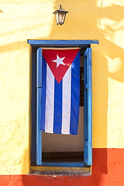 Cuban Flag in doorway, Trinidad, UNESCO World Heritage Site, Sancti Spiritus, Cuba, West Indies, Caribbean, Central America