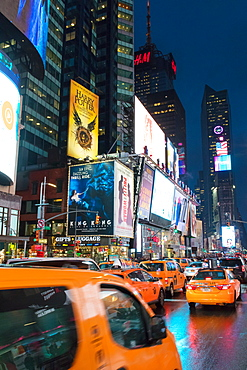 Yellow taxis in Times Square at night. New York City, New York, United States of America, North America