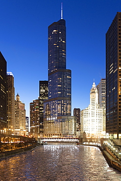 Trump Tower and The Wrigley Building at dusk, overlooking a frozen Chicago River, Chicago, Illinois, United States of America, North America