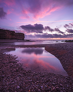 Dawn clouds at mouth of River Otter at Budleigh Salterton, Devon, England, United Kingdom, Europe