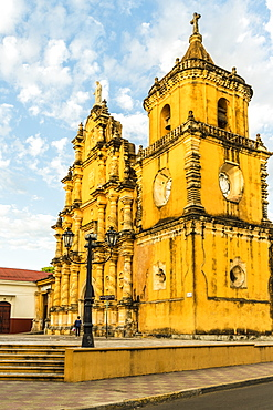 A view of the colourful baroque facade of the Church of the Recollection, Leon, Nicaragua, Central America