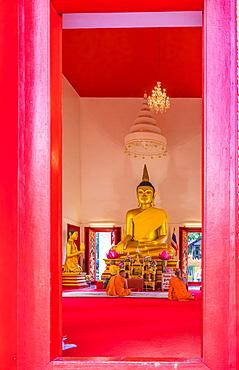 Monks in Mongkol Nimit temple (Wat) in Phuket old town, Phuket, Thailand, Southeast Asia, Asia
