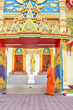 A monk at Mongkol Nimit temple (Wat) in Phuket old town, Phuket, Thailand, Southeast Asia, Asia