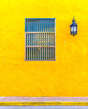 The facade of a colourful traditional building in the old town in Cartagena de Indias, Colombia, South America