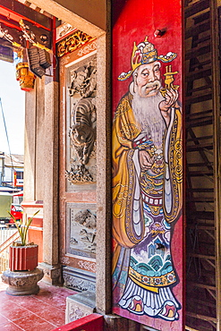 An ornate colourful door at Eng Chuan Tong Tan Kongsi clan house in George Town, Penang Island, Malaysia, Southeast Asia, Asia
