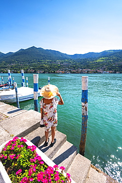 Woman admiring the Iseo Lake seen from Monte Isola, the largest lake island in Europe, Province of Brescia, Lombardy, Italy, Europe
