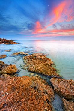 Rocks on the Salento coast at sunset, Dunes of Campomarino, Taranto province, Apulia, Italy, Europe