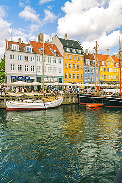 Nyhavn with old colourful buildings and boats anchored in summer, Copenhagen, Denmark, Europe