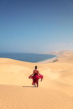 Model within Sandwich Harbour, Skeleton Coast, Namibia, Africa