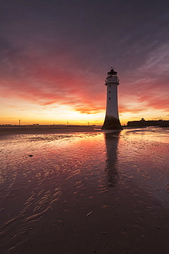 Dramatic sunrise at Perch Rock Lighthouse, New Brighton, Merseyside, The Wirral, England, United Kingdom, Europe