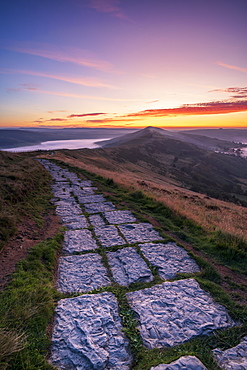 Limestone path leading to Lose Hill and Back Tor from Mam Tor with amazing sunrise, The Peak District National Park, Derbyshire, England, United Kingdom, Europe
