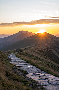The sun rising directly above Lose Hill and Back Tor, The Peak District National Park, Derbyshire, England, United Kingdom, Europe