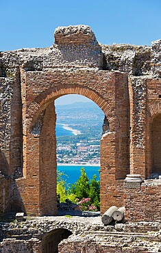 View from the Greek Theatre through arch to the Bay of Naxos, Taormina, Messina, Sicily, Italy, Mediterranean, Europe