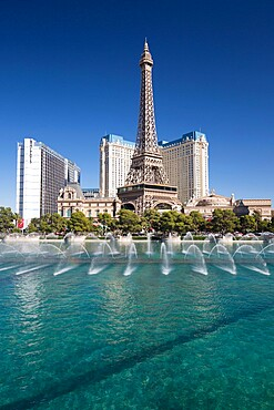 View across lake to replica Eiffel Tower at the Paris Hotel and Casino, Bellagio fountains in foreground, Las Vegas, Nevada, United States of America, North America