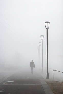 Walking in dense morning fog, French Quarter, New Orleans, Louisiana, United States of America, North America