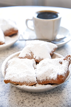 Famous food of New Orleans, beignets and chicory coffee at Cafe Du Monde, New Orleans, Louisiana, United States of America, North America