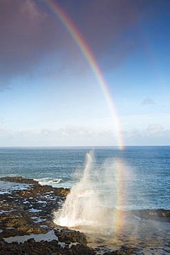 Spouting Horn with a morning rainbow, on the south coast of Kauai near Poipu, Kauai, Hawaii, United States of America, North America