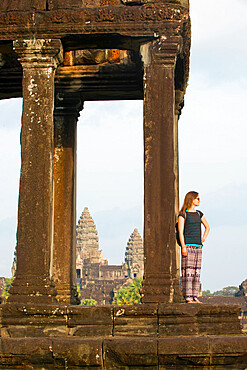 Female tourist gazing out at the Angkor archaeological complex, UNESCO World Heritage Site, Siem Reap, Cambodia, Indochina, Southeast Asia, Asia