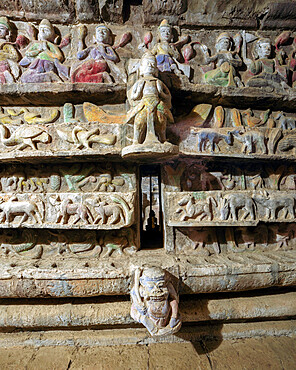 Stone carvings in one of the subterranean corridors in Shitthaung temple with some original colour visible, Mrauk U, Rakhine, Myanmar (Burma), Asia