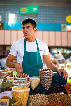 A seller in Zelenyy Bazar (Green bazaar), a farmer's market with stalls selling meat, vegetables and dried fruits, Almaty, Kazakhstan, Central Asia, Asia