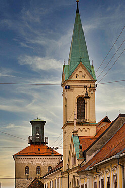 The Historic Lotrscak Tower in the background with a Greek Orthodox Seminary in the foreground. Zagreb, Croatia.