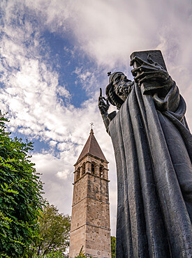 The statue of the Gregory of Nin with the Chapel of the Holy Arnir in the background. Split, Croatia.