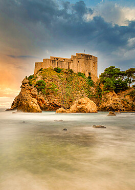 The 16th Century Lovrjenac Fortress at sunset with a long exposure ocean foreground. Dubrovnik, Croatia. - 1320-118