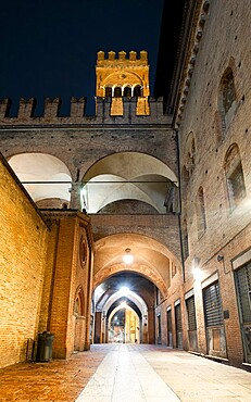 Night view of the Arengo tower in Piazza Maggiore, Bologna, Emilia Romagna, Italy, Europe