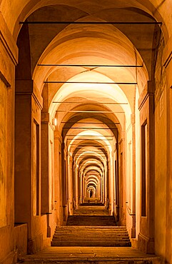 The porticoes of Bologna, the longest in the world, night view of the arches towards the San Luca church, Bologna, Emilia Romagna, Italy, Europe