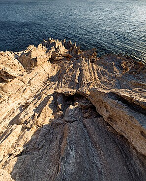 Harsh rock cliffs on Antiparos Island, Cyclades, Greek Islands, Greece, Europe